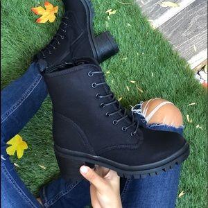Black combat ankle boots
